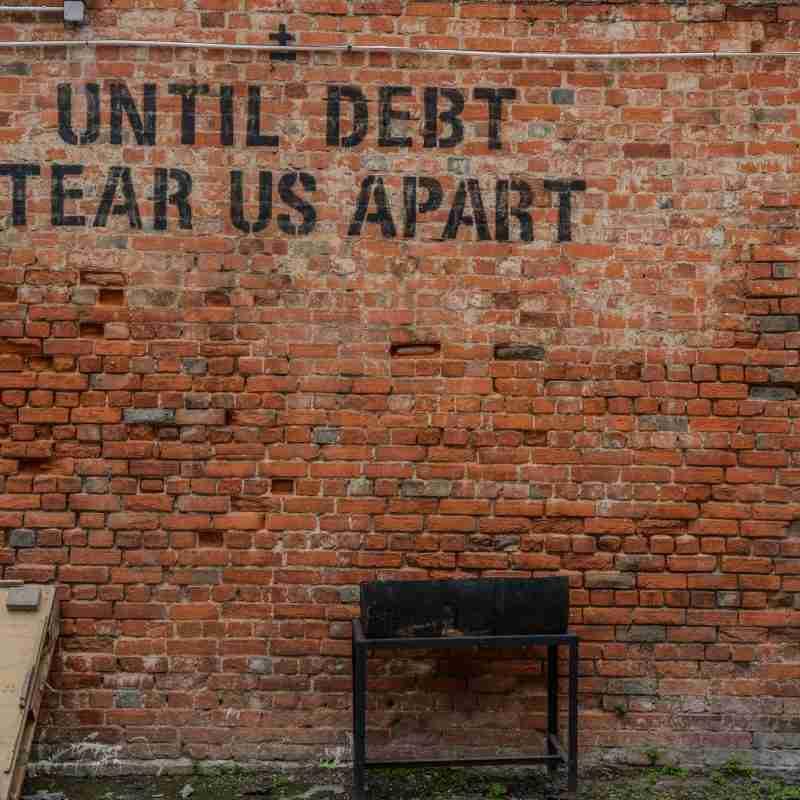 bien raiz que tiene deuda
